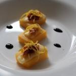 Rettangoli di polenta alla salsa di pomodorini secchi e carciofini